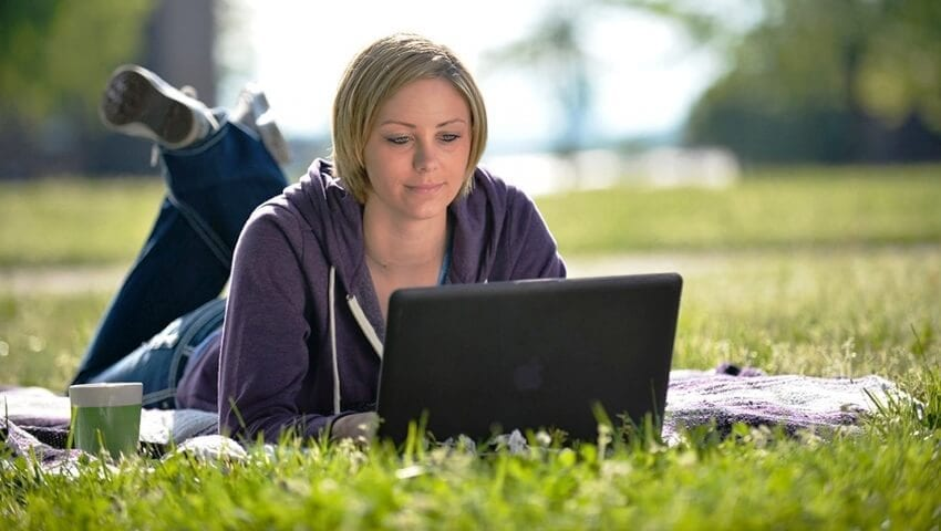 woman on her laptop in a park